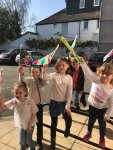 Photo of children waving flags they have made