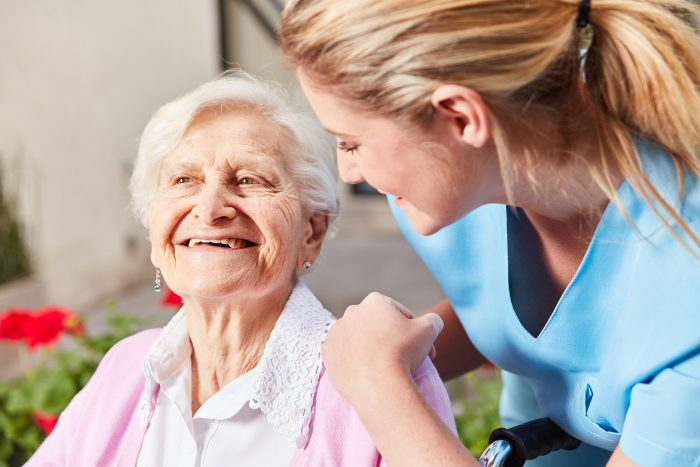 Caring Nurse Caring for an elderly patient