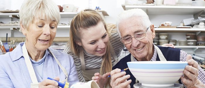 People learning to paint pottery